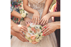 Bridesmaids show their nail color as part of bridesmaid nail ideas.