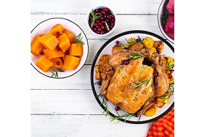 Healthy Thanksgiving meal options Including turkey, sweet potato and cranberries.
