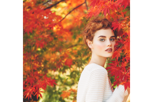 A woman with glowing skin during fall.