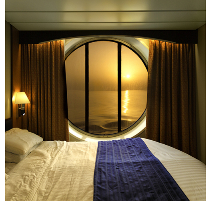 How can you make your cruise cabin feel bigger?