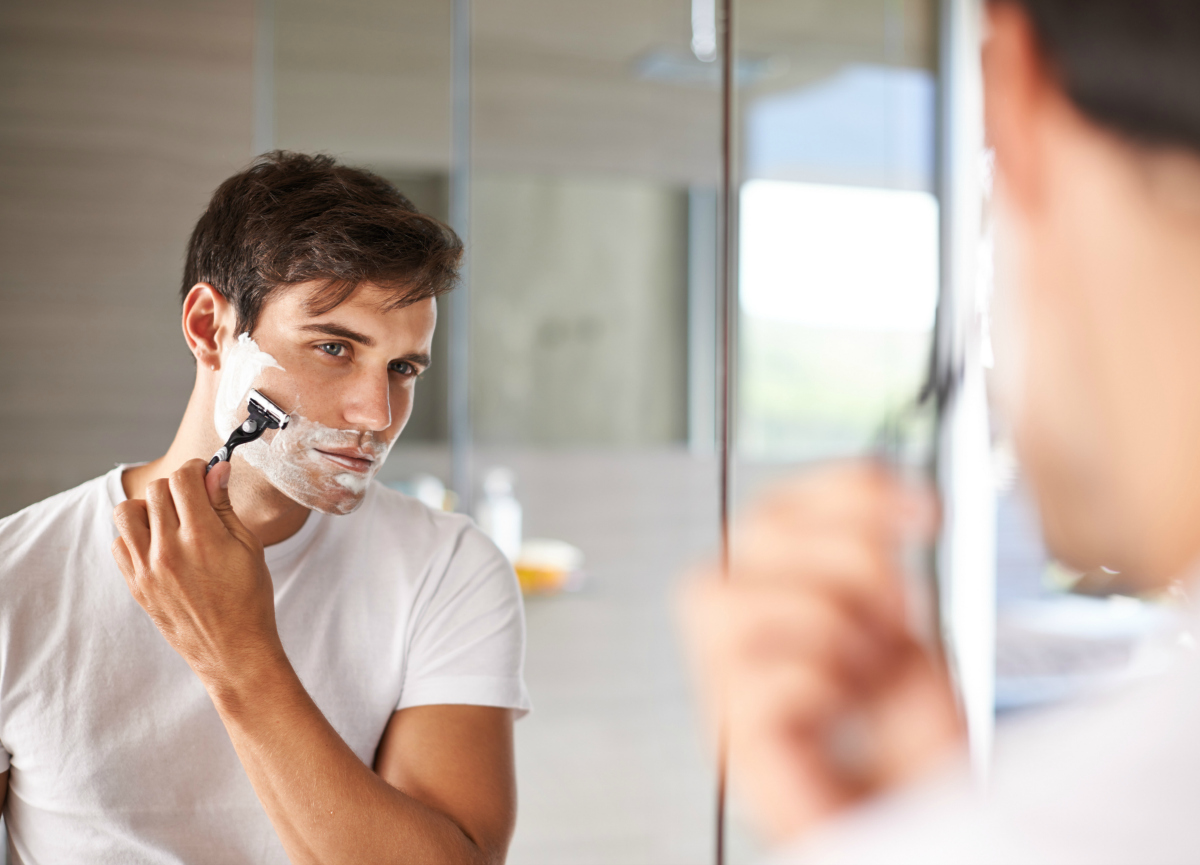 How can men reduce the risk for ingrown hairs?